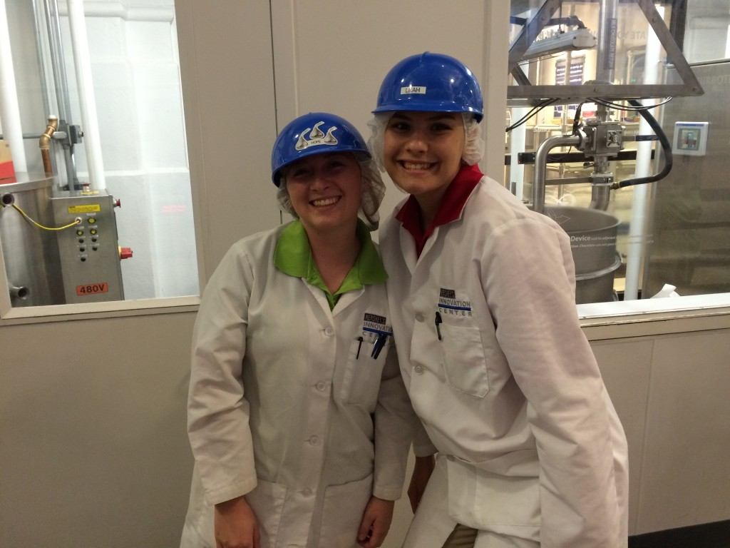 """Hope & Leah work in the """"Create Your Own Candy Bar"""" part of Hershey's Chocolate World."""